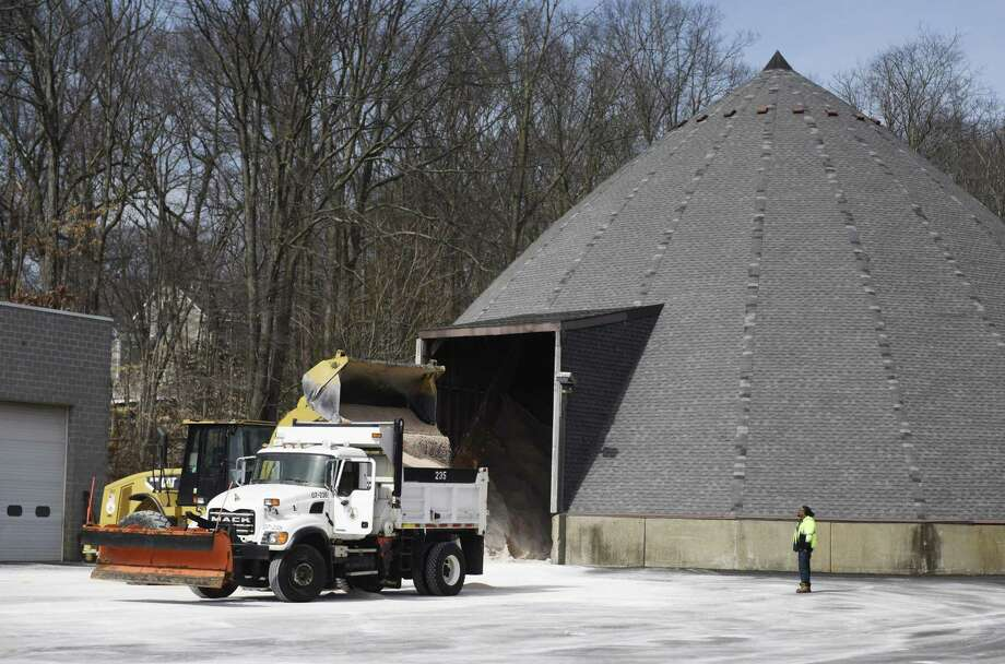 Department of Public Works employees prepare for the impending snowstorm by loading salt and sand into plow trucks at the town yard in the Glenbrook section of Stamford, Conn. Monday, March 13, 2017. Twelve to 20 inches of snow is expected to fall in Stamford staring early Tuesday morning and tapering off in the late evening. Photo: Tyler Sizemore / Hearst Connecticut Media / Greenwich Time