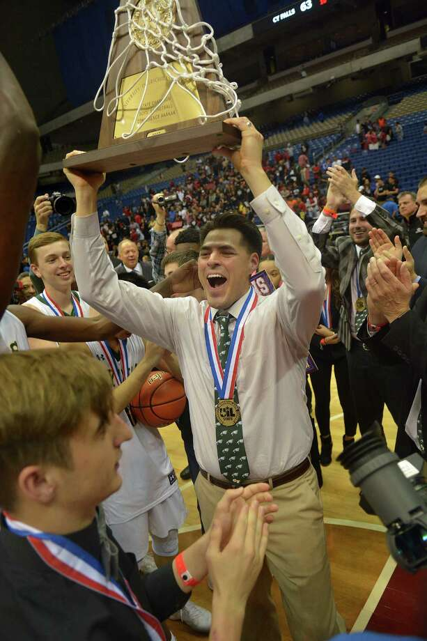 Cy Falls head coach Richard Flores, center, hoists the Eagle's trophy after their 63-57 win over San Antonio Wagner in their Class 6A state final at the Alamodome in San Antonio on Saturday, March 11, 2017. (Photo by Jerry Baker/Freelance) Photo: Jerry Baker, Freelance / Freelance