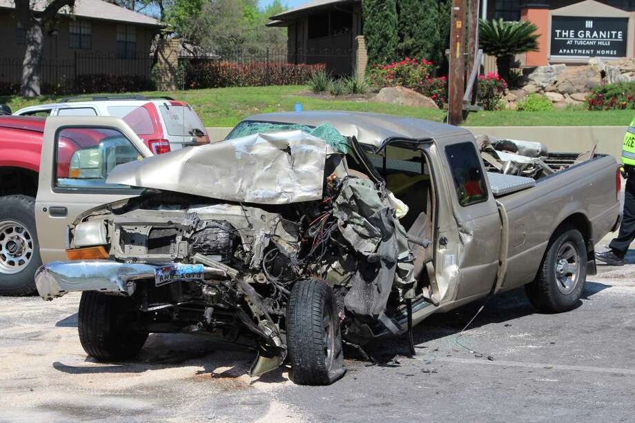 Two men were transported to an area hospital after a two-vehicle crash on Culebra Road near Joe Newton Street on March 13, 2017. Photo: Tyler White, San Antonio Express-News / San Antonio Express-News