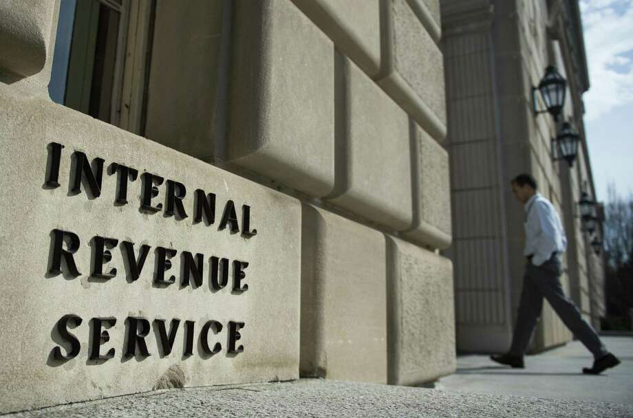 A man walks into the Internal Revenue Service building in Washington, D.C. All IRS Taxpayer Assistance Centers, including the one in San Antonio, are available by appointment only. Photo: ANDREW CABALLERO-REYNOLDS /AFP /Getty Images / This content is subject to copyright.