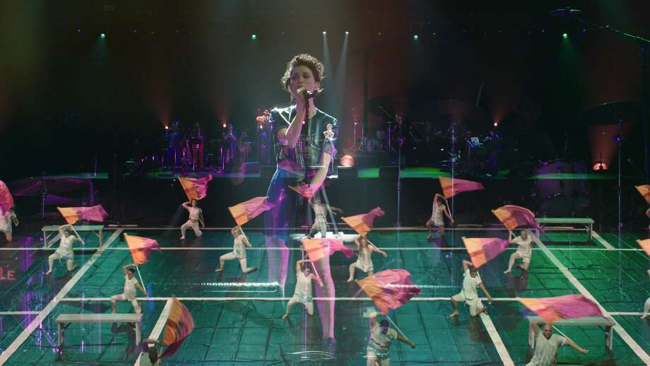 Singer St. Vincent performs with one of the 10 color guards in a concert documentary with impres sive choreo graphy. Photo: Oscilloscope Films
