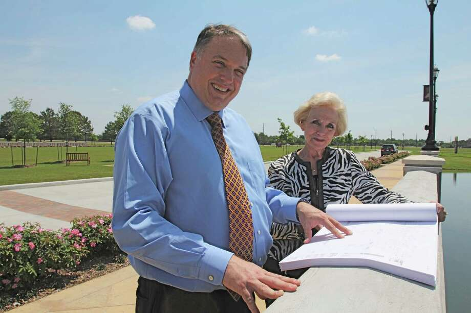 Ann Hodge, CEO of the Katy Area Chamber of Commerce and Lance LaCour, CEO of the Greater Katy Economic Development Corporation look at plans for the expansion of LaCenterra at Cinco Ranch.  Suzanne Rehak/For the Chronicle Photo: Suzanne Rehak, Freelance Photographer