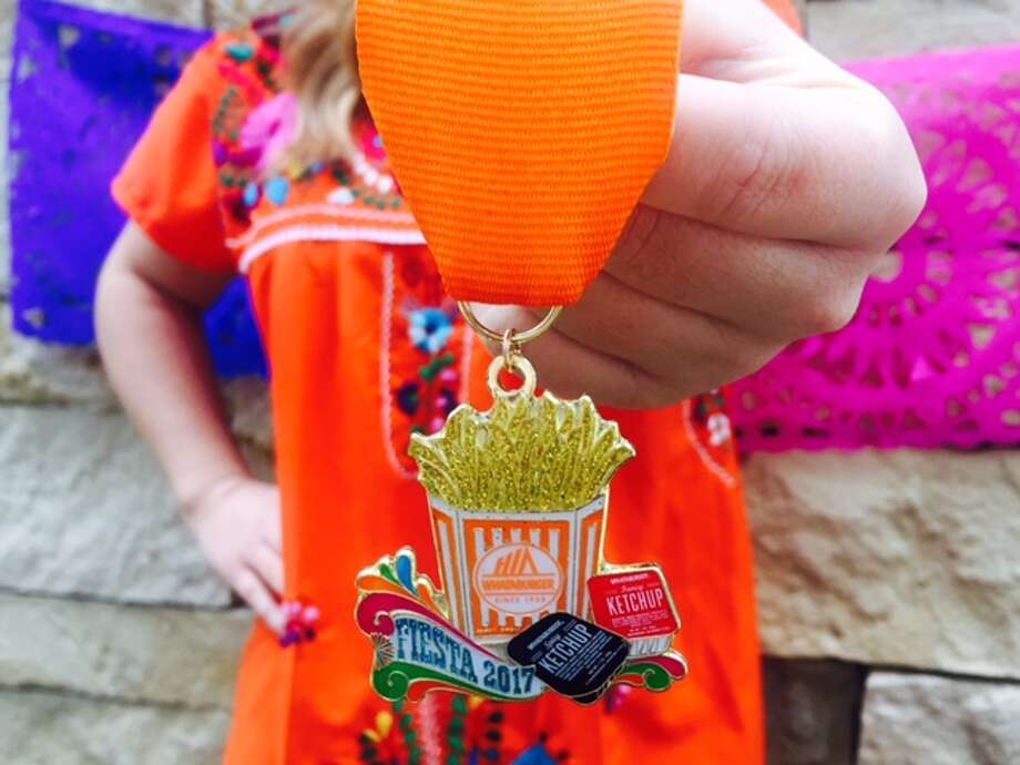 On Tuesday at 3 p.m., Whataburger's downtown location at 412 E. Commerce Street  will host a pop-up store, giving customers the exclusive chance to buy the chain's 2017 medal before it is released to the general public online. Photo: Provided By Whataburger