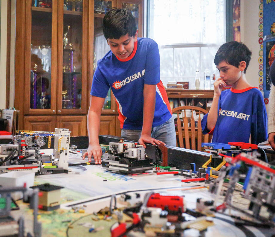 Vali Khan, 13, and Tito Manzur, 11, demonstrate how their LEGO prototypes work during a meeting of their Bricksmart Woodlands Robotics team on Monday, Feb. 20, 2017, at the Rubicon Academy in Conroe. Photo: Michael Minasi, Staff Photographer / © 2017 Houston Chronicle