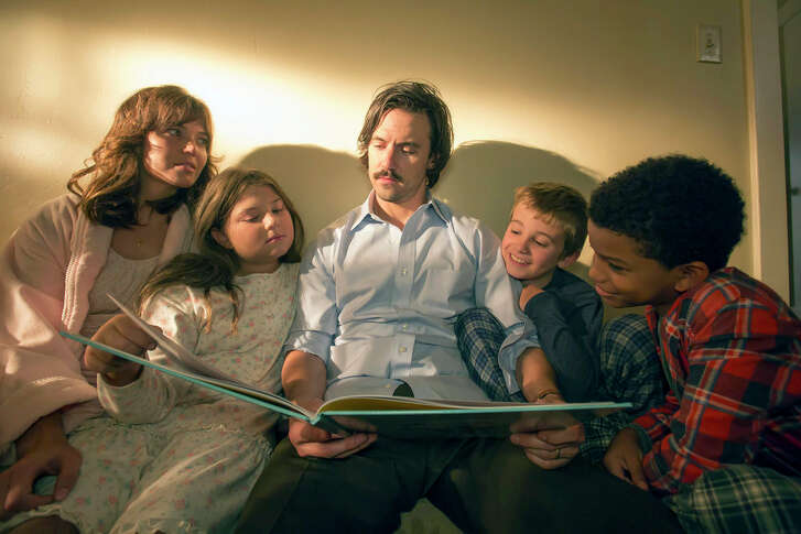 """Mandy Moore, from left, is Rebecca, Mackenzie Hancsicsak is Kate, Milo Ventimiglia is Jack, Parker Bates is Keven and Lonnie Chavis is Randall in """"This Is Us."""""""