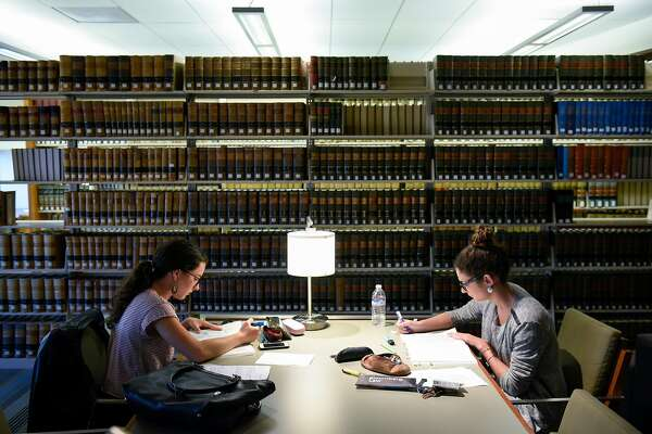 French exchange students Jeanne Briand, left, and Geraldine Gonzalez study for the BAR test in the library at UC Hastings College of the Law in San Francisco, CA, on Monday March 13, 2017.