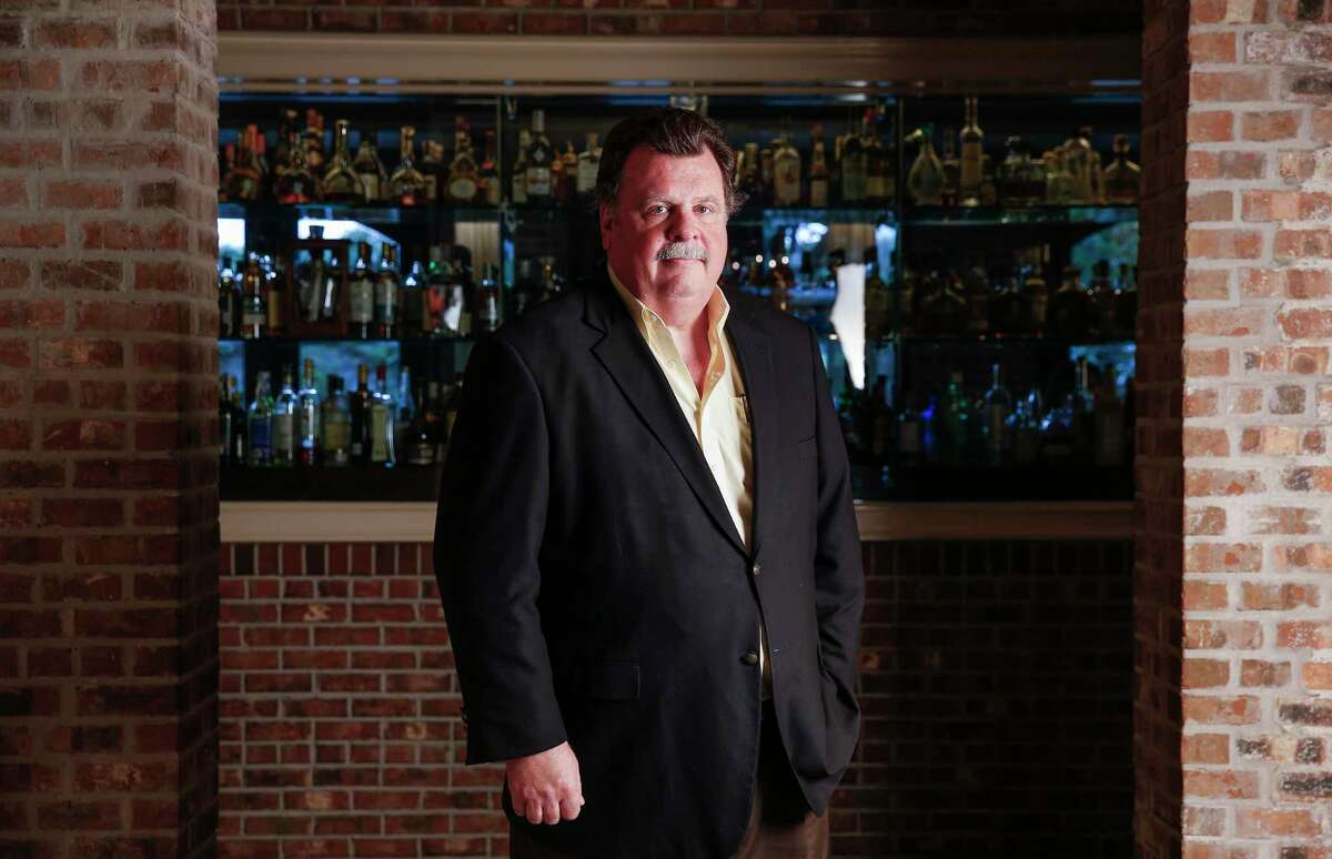 Brennan's of Houston owner Alex Brennan-Martin stands for a portrait in the family restaurant that turns 50 this year.