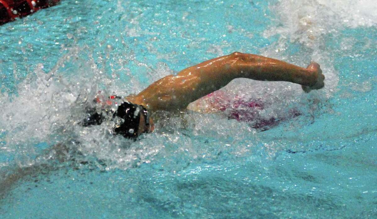 New Canaan's Bhaskar Abhiraman swims in the 200 freestyle at the Class L championships on Monday.