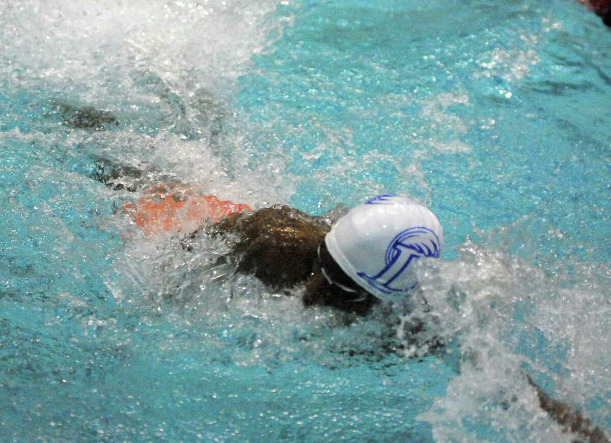 Darien's Tahj Thompson swims during the Class L championships on Monday.