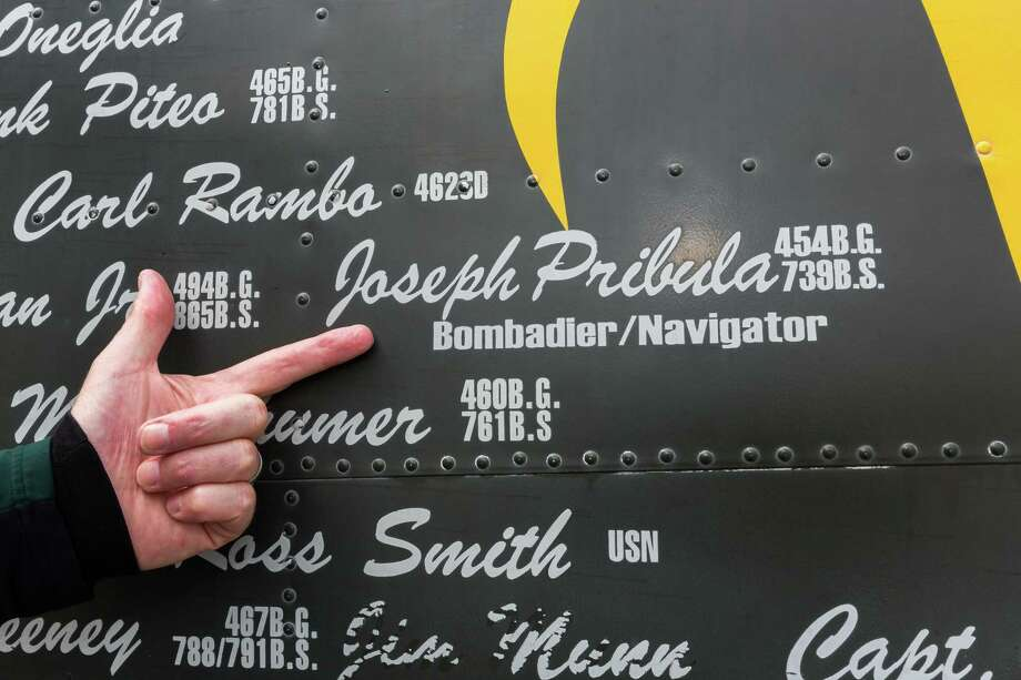 """March 13, 2017:  Visitor points out the names of pilots that flew the Consolidated B-24 Liberator, """"Witchcraft"""" on display at The Wings of Freedom Tour at Ellington Field in Houston, Texas.  (Leslie Plaza Johnson/Freelance) Photo: Leslie Plaza Johnson, For The Chronicle / Freelance"""