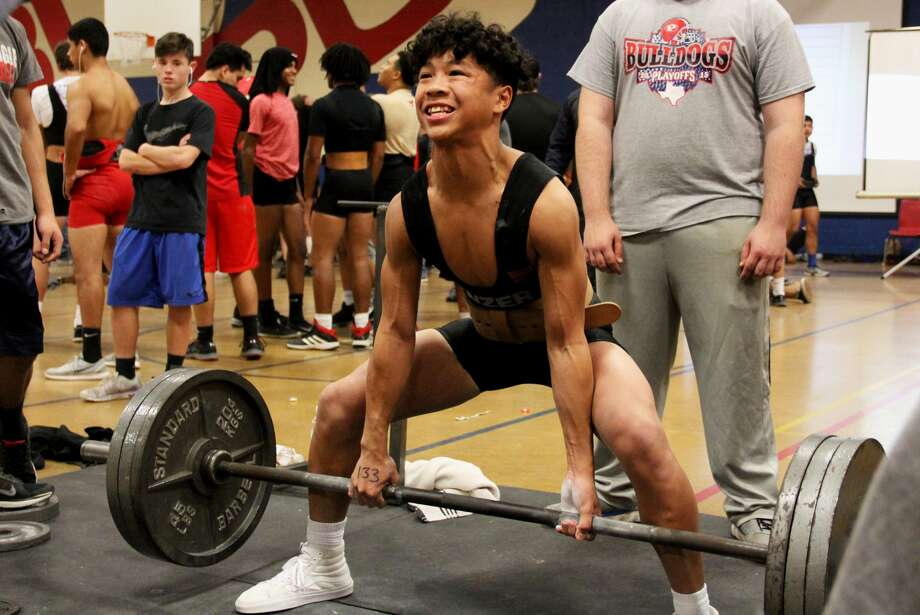 Plainview's Kevin Phan executes a dead lift during a meet earlier this season. Phan finished second in the 133-pound weight class at the regional powerlifting meet in Abilene Saturday and was one of 10 Bulldogs to qualify for the state meet. Photo: Curtis Bailey/Plainview ISD