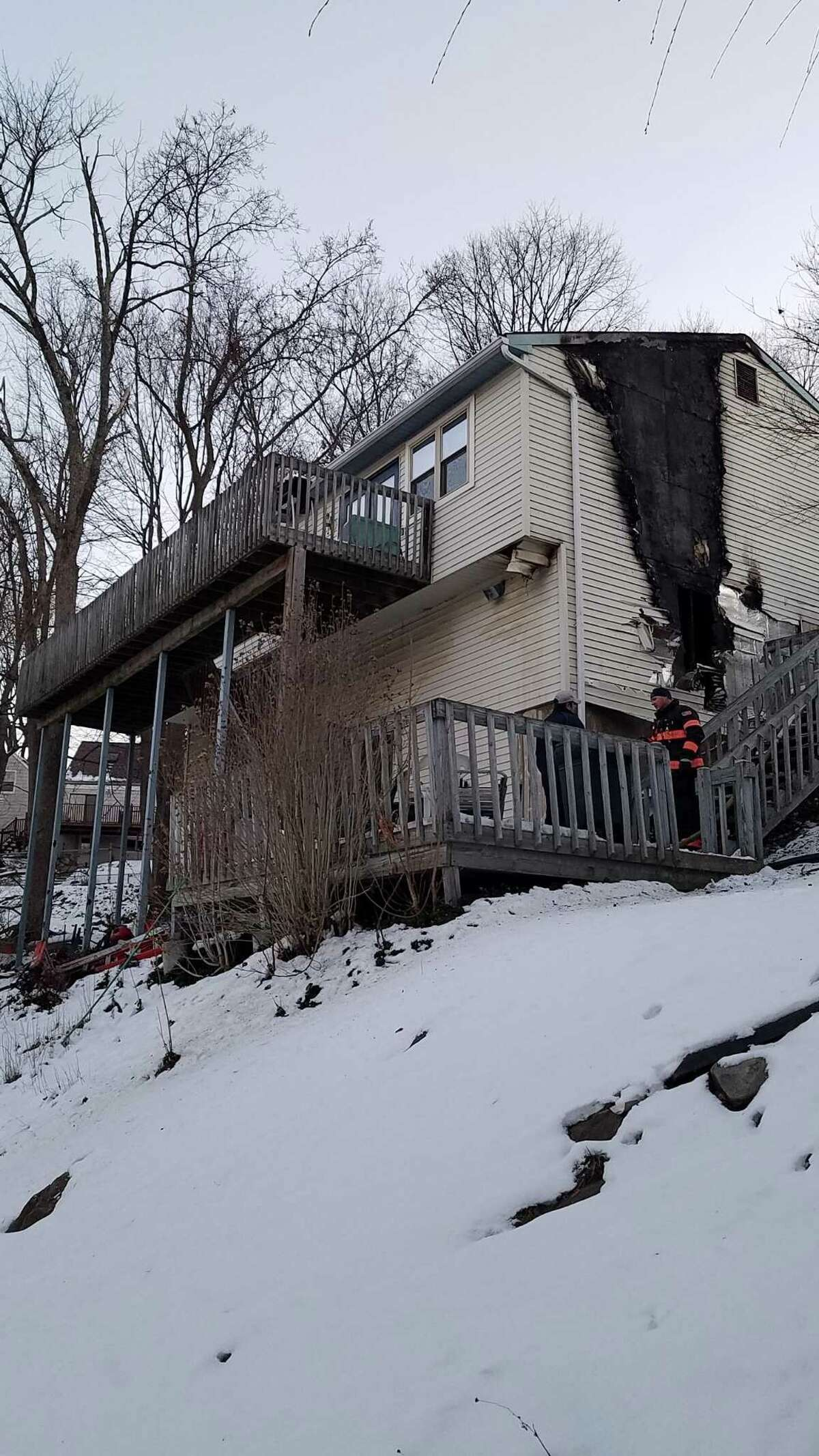 A home on Fleetwood Drive that erupted into flames Sunday.