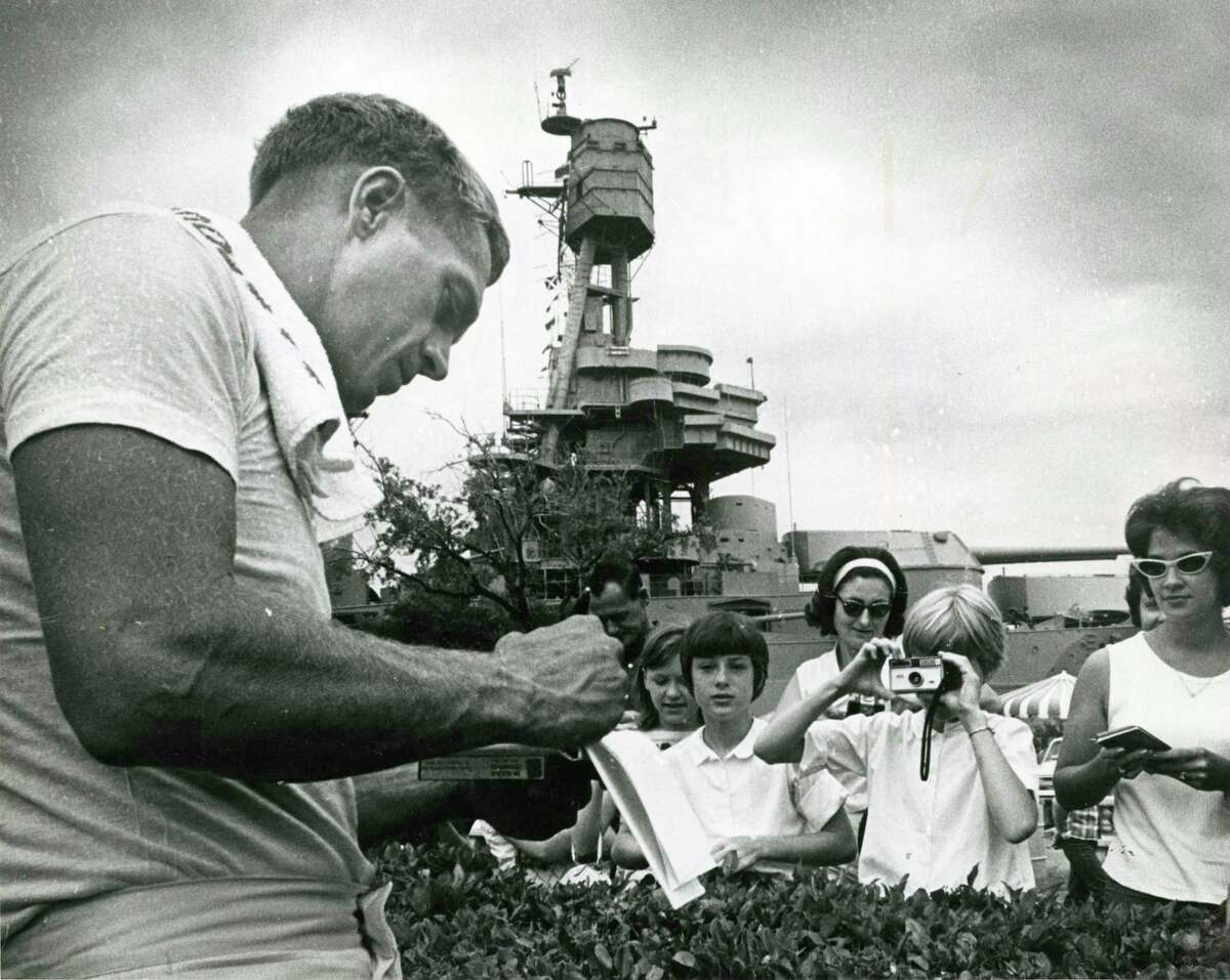 McQueen signs autographs during a break from filming. aboard the USS Texas for