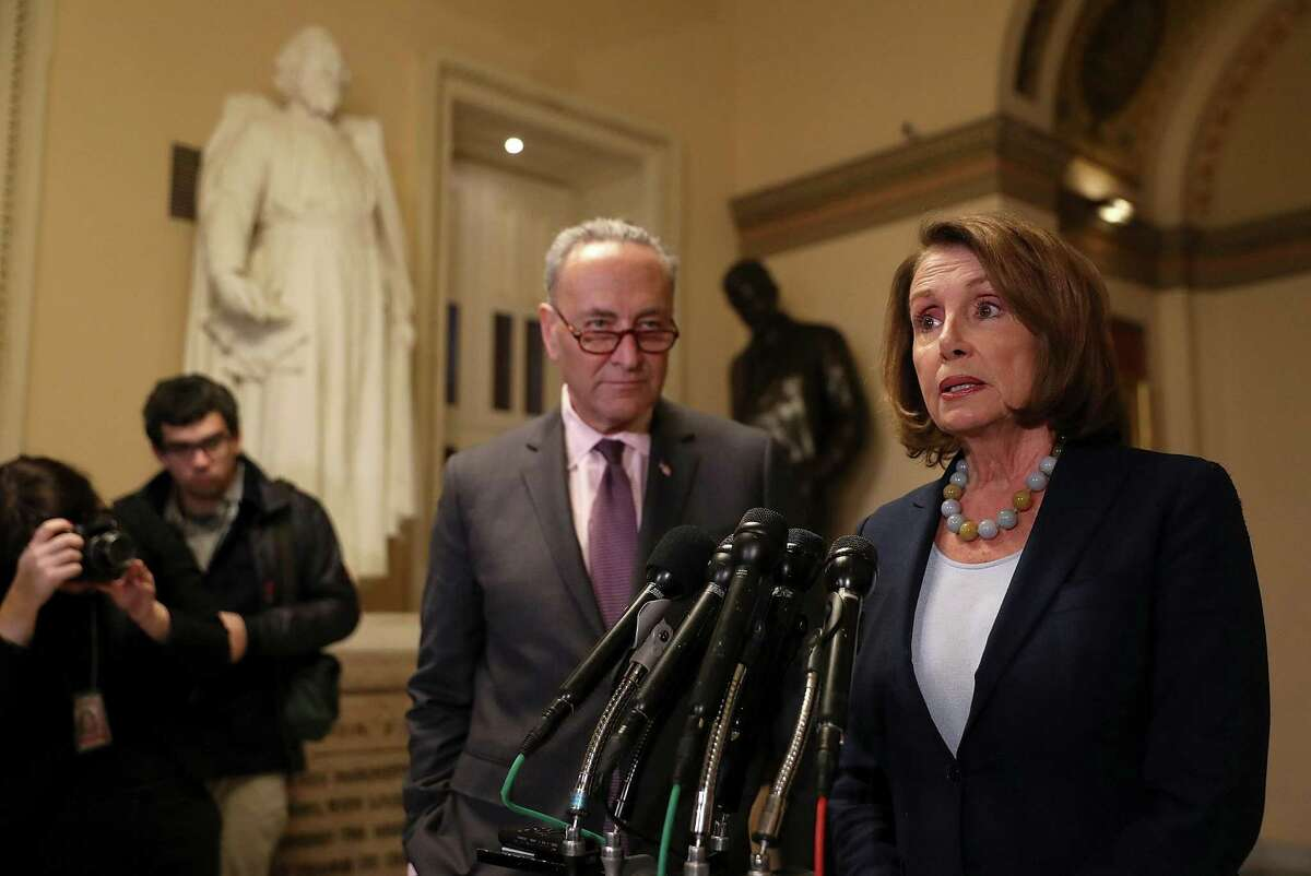 WASHINGTON, DC - MARCH 13: Senate Minority Leader Charles Schumer (L) (D-NY) looks on as House Minority Leader Nancy Pelosi (D-CA) speaks to reporters during a news conference at the U.S. Capitol on March 13, 2017 in Washington, DC. House Minority Leader Nancy Pelosi and Senate Minority Leader Charles Schumer (D-NY) held a news conference to react to the CBO report on the proposed American Health Care Act. (Photo by Justin Sullivan/Getty Images)