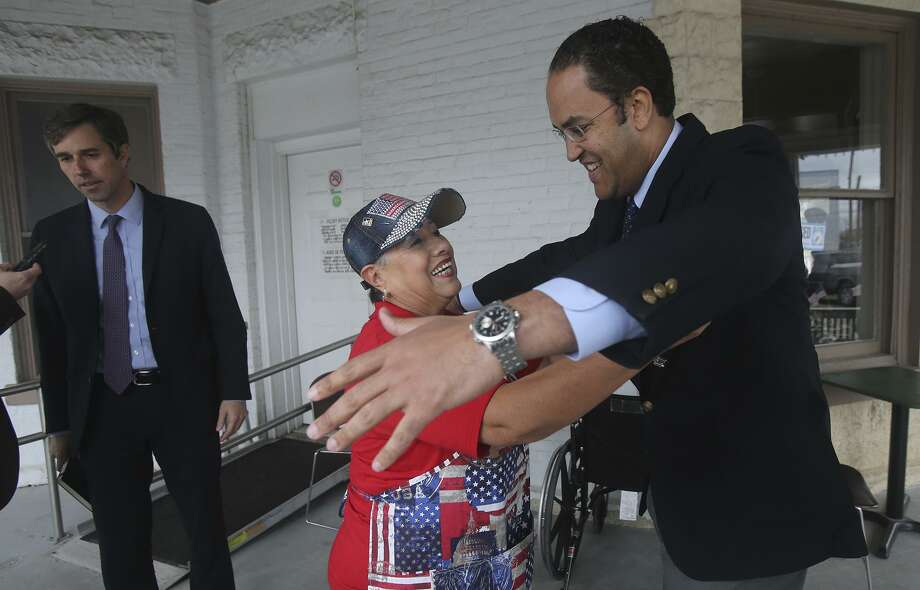 U.S. Rep. Will Hurd, R-Helotes, (right) hugs Yolanda Chambers on Monday  at VFW Hall 76. Hurd and U.S. Rep. Beto O'Rourke (left) D-El Paso, visited San Antonio to talk with area veterans about issues affecting the veteran community. Photo: Photos By John Davenport /San Antonio Express-News / ©San Antonio Express-News/John Davenport