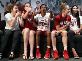 Stanford University women's basketball's Briana Roberson (center) joins teammates in reacting to a surprising seed before the Cardinal's NCAA Tournament seeding was announced. The team watched the bracket announcement on television in their locker room at Maples Pavilion in Stanford, Calif., on Monday, March 13, 2017.