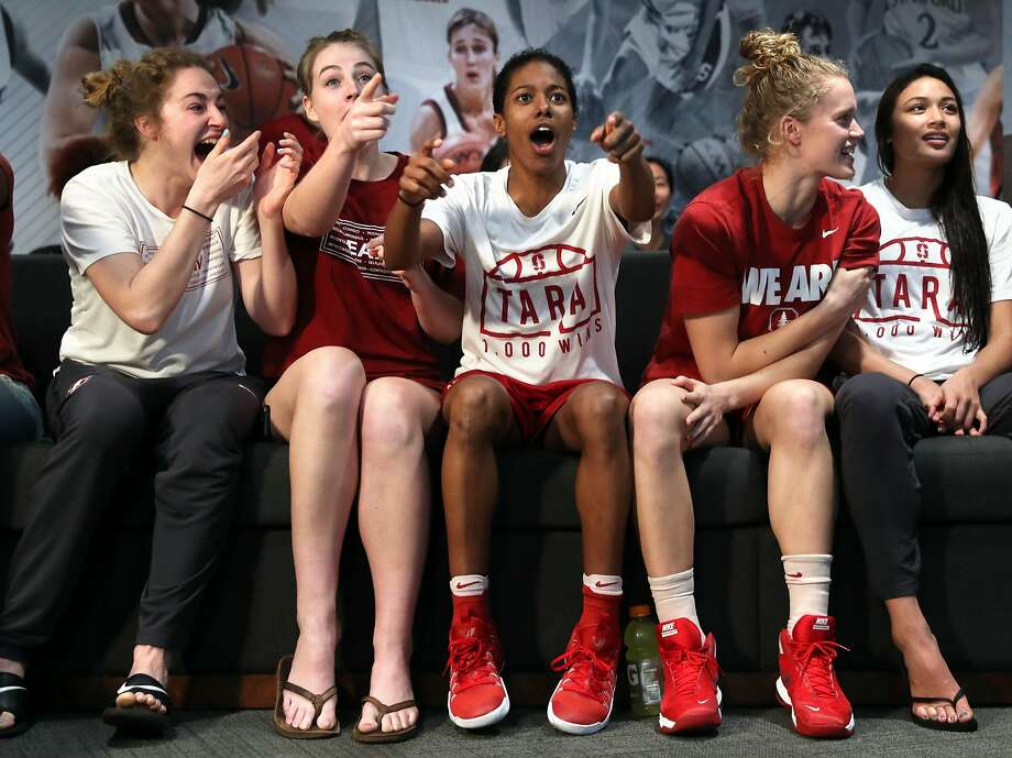 Stanford University women's basketball's Briana Roberson (center) joins teammates in reacting to a surprising seed before the Cardinal's NCAA Tournament seeding was announced. The team watched the bracket announcement on television in their locker room at Maples Pavilion in Stanford, Calif., on Monday, March 13, 2017. Photo: Scott Strazzante, The Chronicle