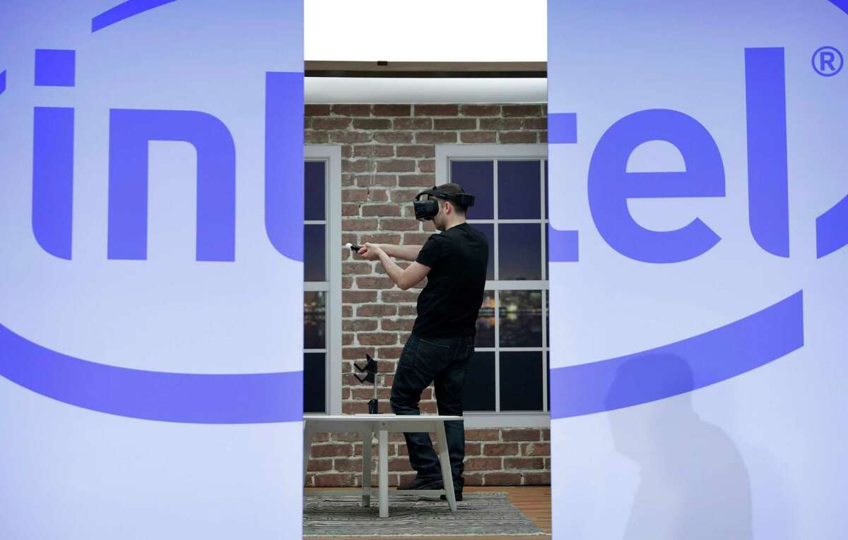 FILE - In this Wednesday, Jan. 4, 2017, file photo, a model demonstrates a Project Alloy all-in-one merged reality headset during an Intel news conference before CES International, in Las Vegas. Intel is buying Mobileye in a deal announced Monday, March 13, 2017 and valued at about $14.09 billion, the latest push by a major tech company into autonomous vehicles that could change the way traffic moves globally. (AP Photo/John Locher, File) ORG XMIT: NYAG106