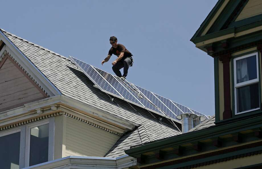A Sungevity worker installs solar panels in San Francisco. Photo: Hardy Wilson, The Chronicle