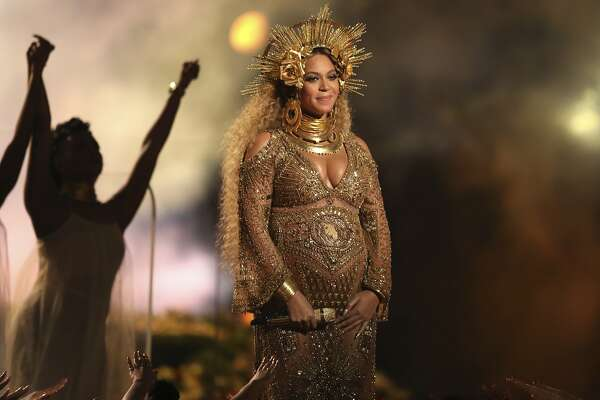 FILE - This Feb. 12, 2017 file photo shows Beyonce performing at the 59th annual Grammy Awards in Los Angeles. Beyonce and Jay Z, along with George and Amal Clooney, have announced recently that they are expecting twins.  (Photo by Matt Sayles/Invision/AP, File)
