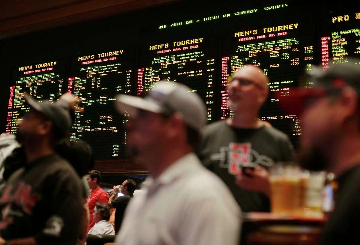 Odds for second-round NCAA basketball tournament games are displayed on a board at the Mirage hotel-casino Race & Sports Book in Las Vegas in 2013. There could be 70 million-plus office pool brackets.