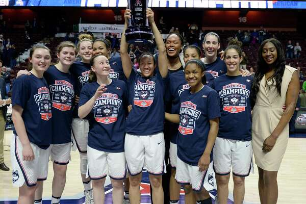 FILE - In this March 6, 2017, file photo, the Connecticut women's basketball team pose with the American Athletic Conference championship trophy after defeating South Florida in an NCAA college basketball game tournament final in Uncasville, Conn.  UConn finishes the season at No. 1 in The Associated Press women's basketball poll for the 14th time in school history. (AP Photo/Jessica Hill, File) ORG XMIT: NY170