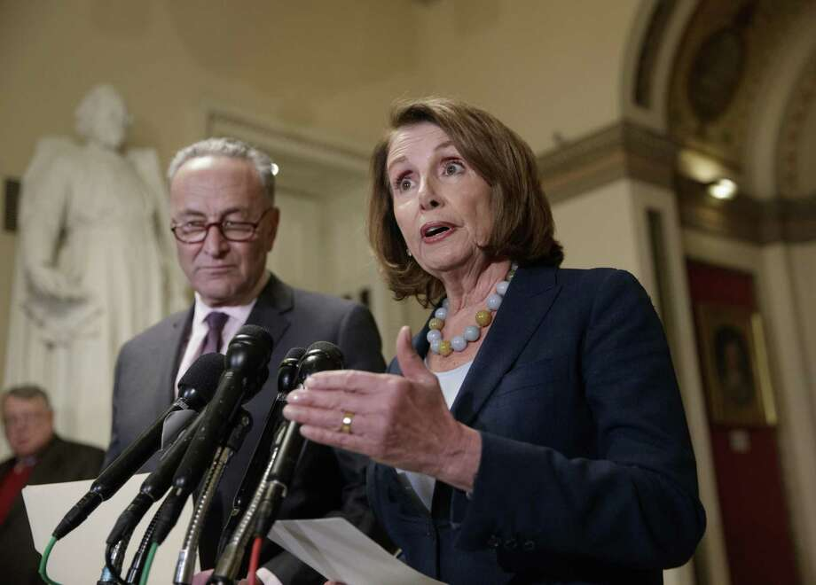 House Democratic Leader Nancy Pelosi of California, and Senate Democratic Leader Chuck Schumer of New York speak to reporters about the Congressional Budget Office projection that 14 million people would lose health coverage under the House Republican bill dismantling former President Barack Obama's health care law, on Capitol Hill in Washington, Monday, March, 13, 2017. (AP Photo/J. Scott Applewhite) Photo: J. Scott Applewhite, STF / Associated Press / AP