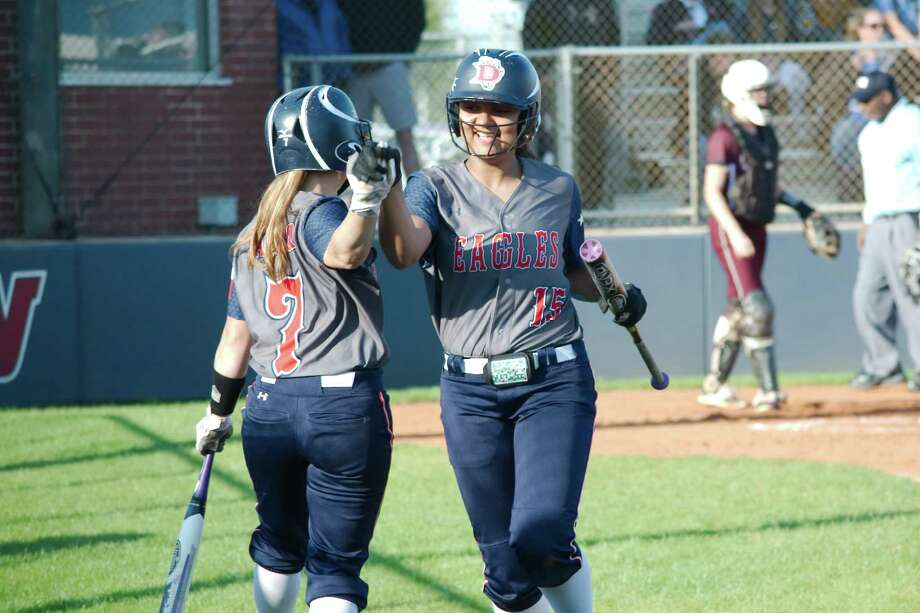 Dawson's Kyra Lunford (15) gets a high five from Dawson's Amber Langston (7) after scoring a run against Pearland Monday, Mar 13 at Dawson High School. Photo: Kirk Sides / © 2017 Kirk Sides / Houston Chronicle