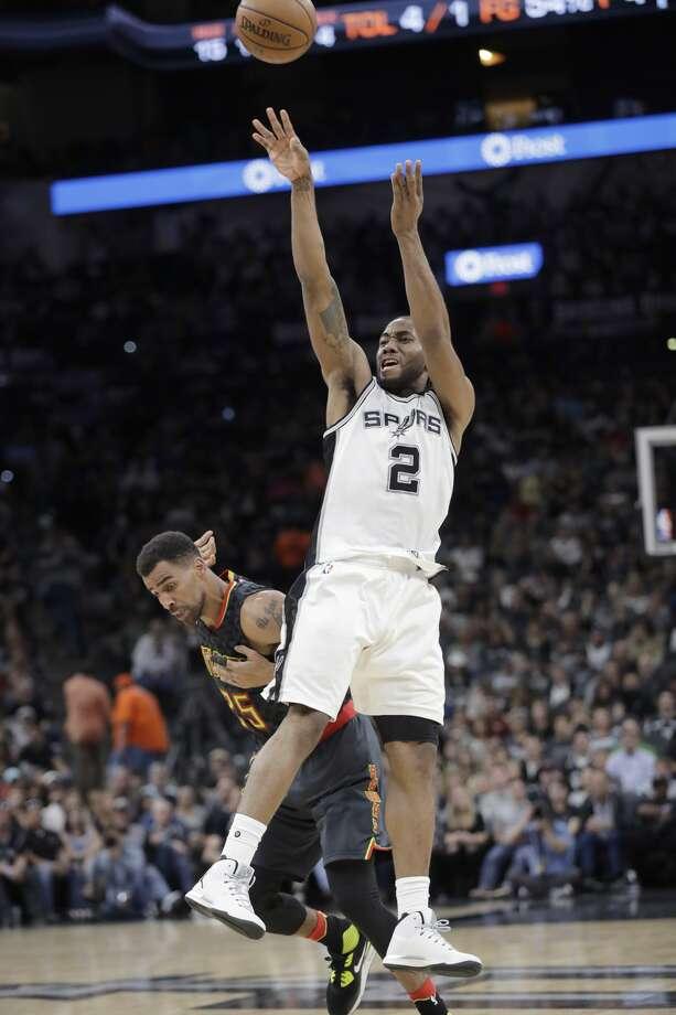 San Antonio Spurs forward Kawhi Leonard (2) shoots over Atlanta Hawks forward Thabo Sefolosha (25) during the first half of an NBA basketball game, Monday, March 13, 2017, in San Antonio. (AP Photo/Eric Gay) Photo: Eric Gay/Associated Press