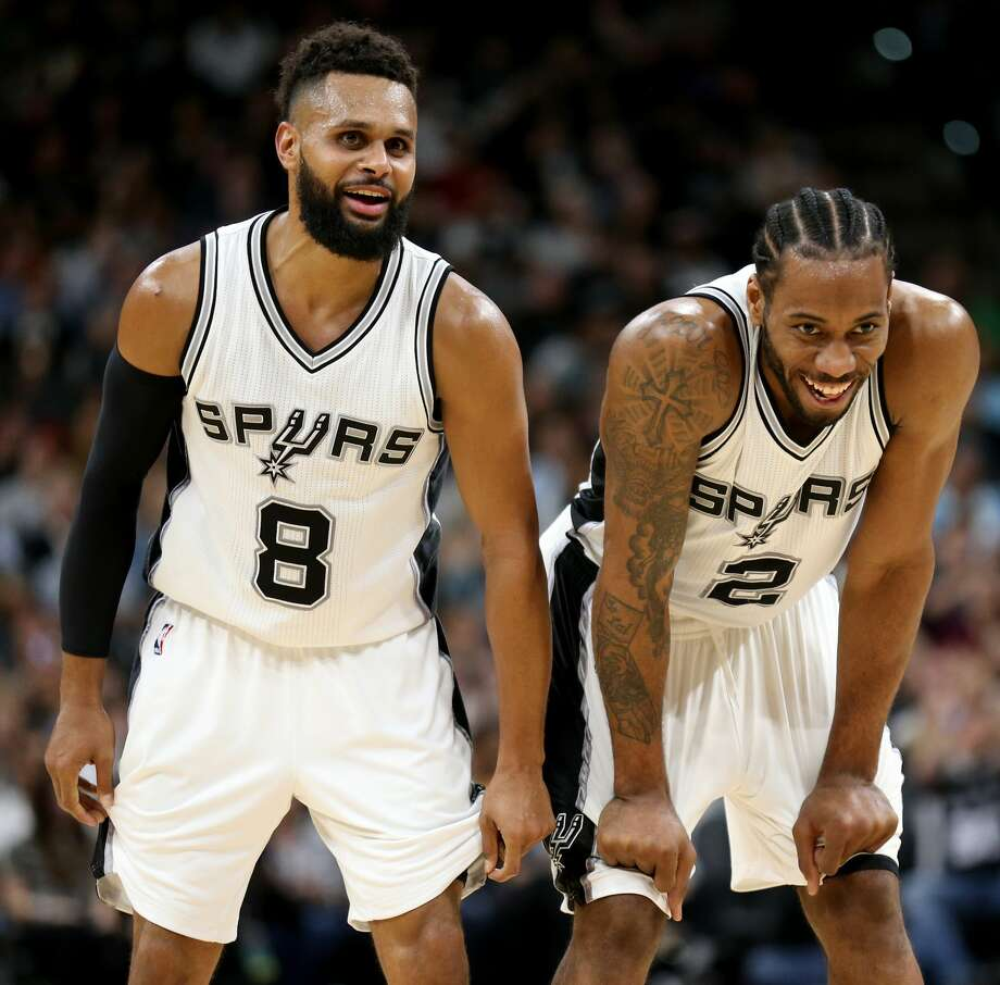 San Antonio Spurs' Patty Mills and Kawhi Leonard joke after a Leonard basket and Leonard being fouled during first half action against the Atlanta Hawks Monday March 13, 2017 at the AT&T Center. Photo: Edward A. Ornelas/San Antonio Express-News