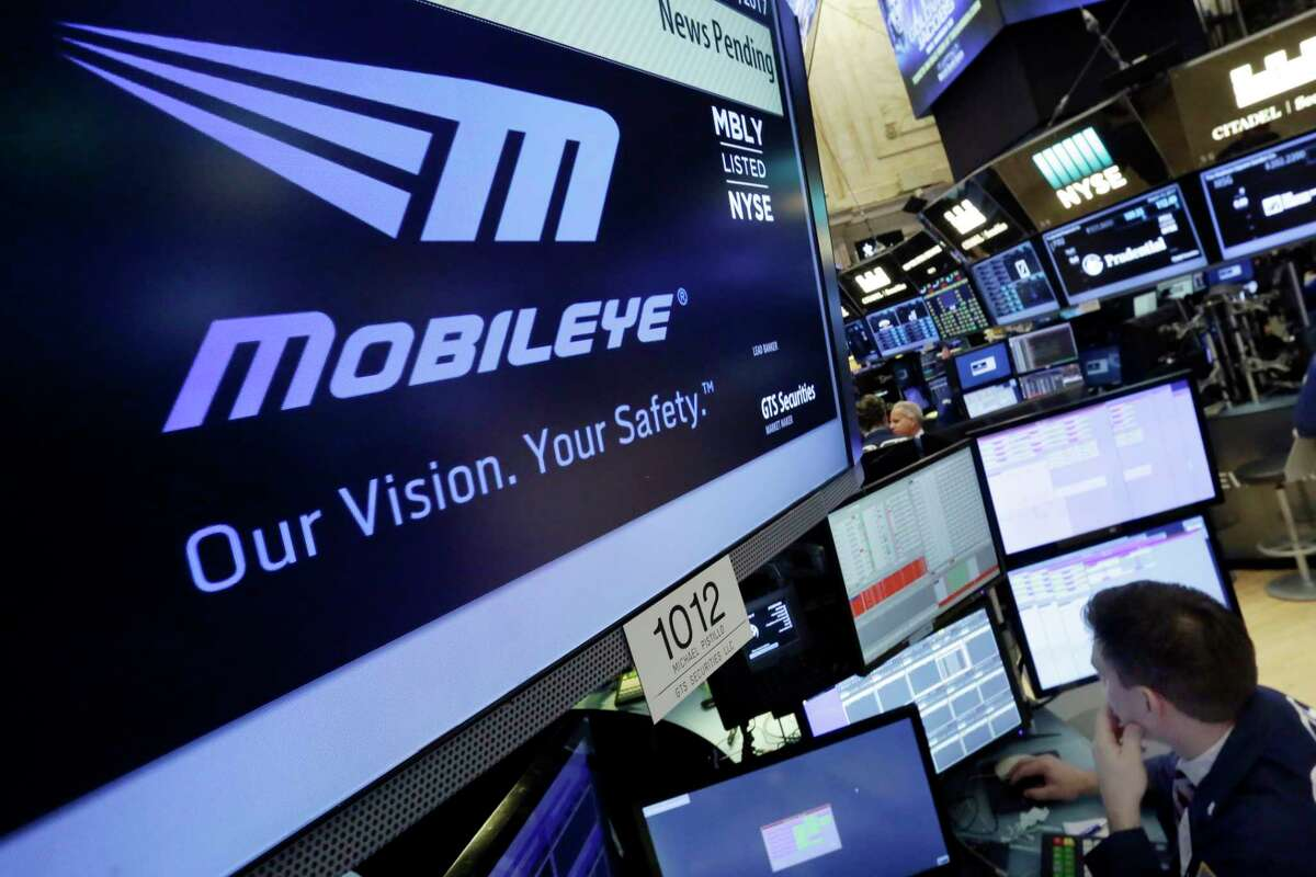 The Mobileye logo appears on a screen at the post where it trades on the floor of the New York Stock Exchange, Monday, March 13, 2017. Intel will buy Israel's Mobileye in a deal valued at just over $14 billion, the latest push by a major tech company to advance autonomous vehicles that could change the way traffic moves globally. (AP Photo/Richard Drew)