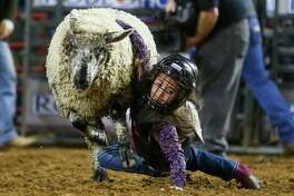 Khloe Jenkins, 6, falls off her sheep during the mutton bustin' competition at the Houston Livestock Show and Rodeo Monday, March 13, 2017 in Houston.