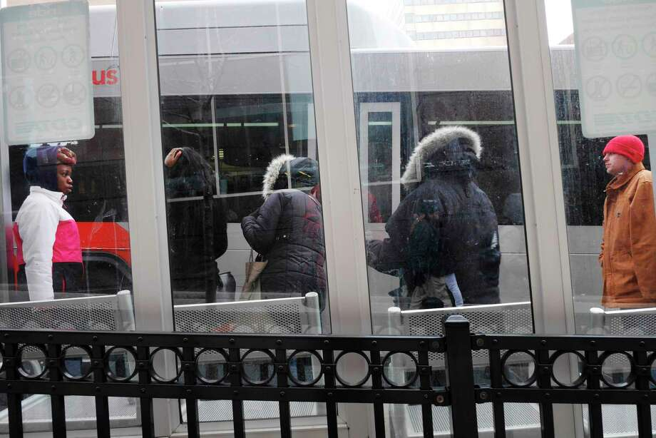 People wait for their bus in the cold along State Street on Monday, March 13, 2017, in Albany, N.Y.     (Paul Buckowski / Times Union) Photo: STAFF / 20039944A