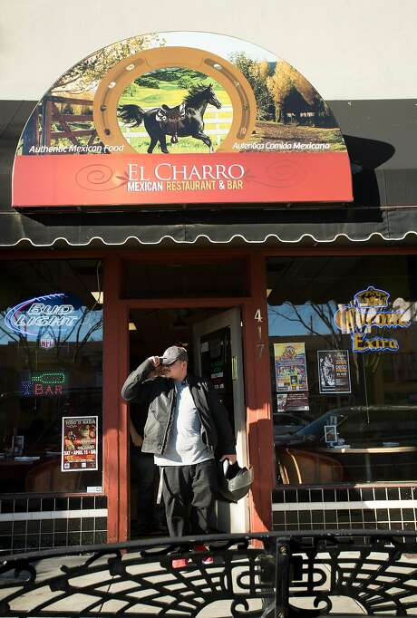 A patron leaves El Charro. Photo: Noah Berger, Special To The Chronicle