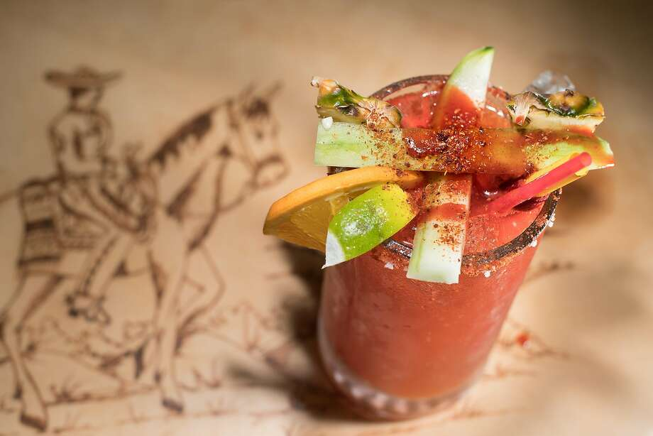 Spices and fruits atop a michelada at El Charro, which offers a full-service bar. Photo: Noah Berger, Special To The Chronicle