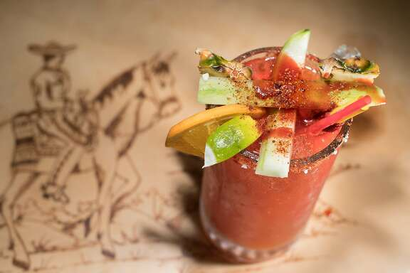 Spices and fruits rest atop a michelada at El Charro on Friday, March 10, 2017, in Woodland, Calif.