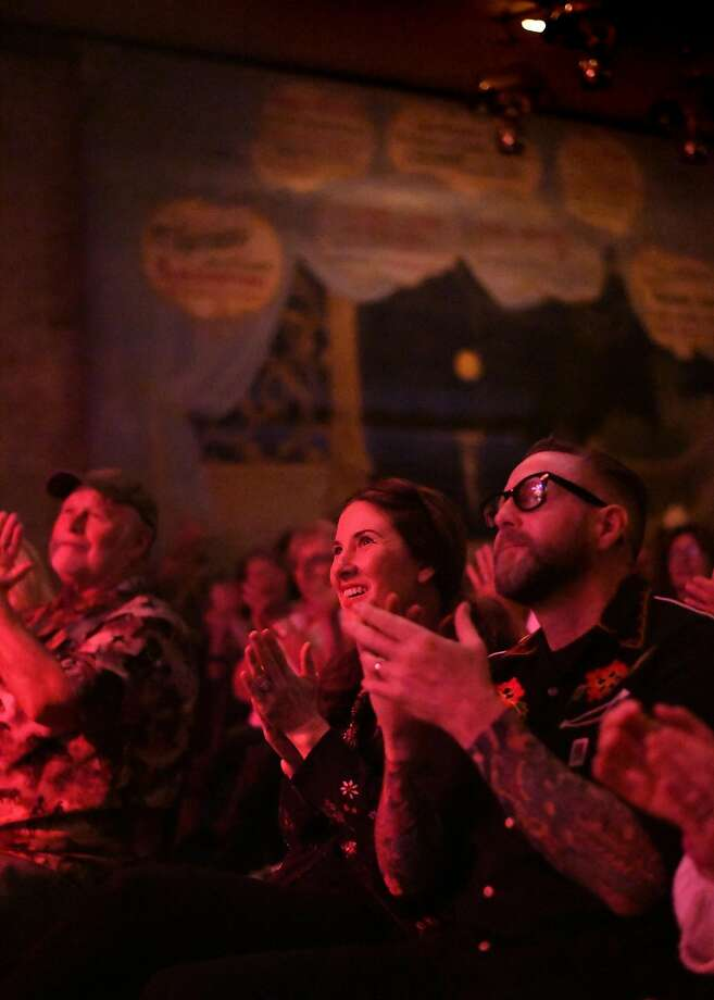Audience members Jennifer and Brent Rector (left) applaud the Nickel Slots during a show at the revived Palms Playhouse music hall in Winters (Yolo County). Photo: Noah Berger, Special To The Chronicle