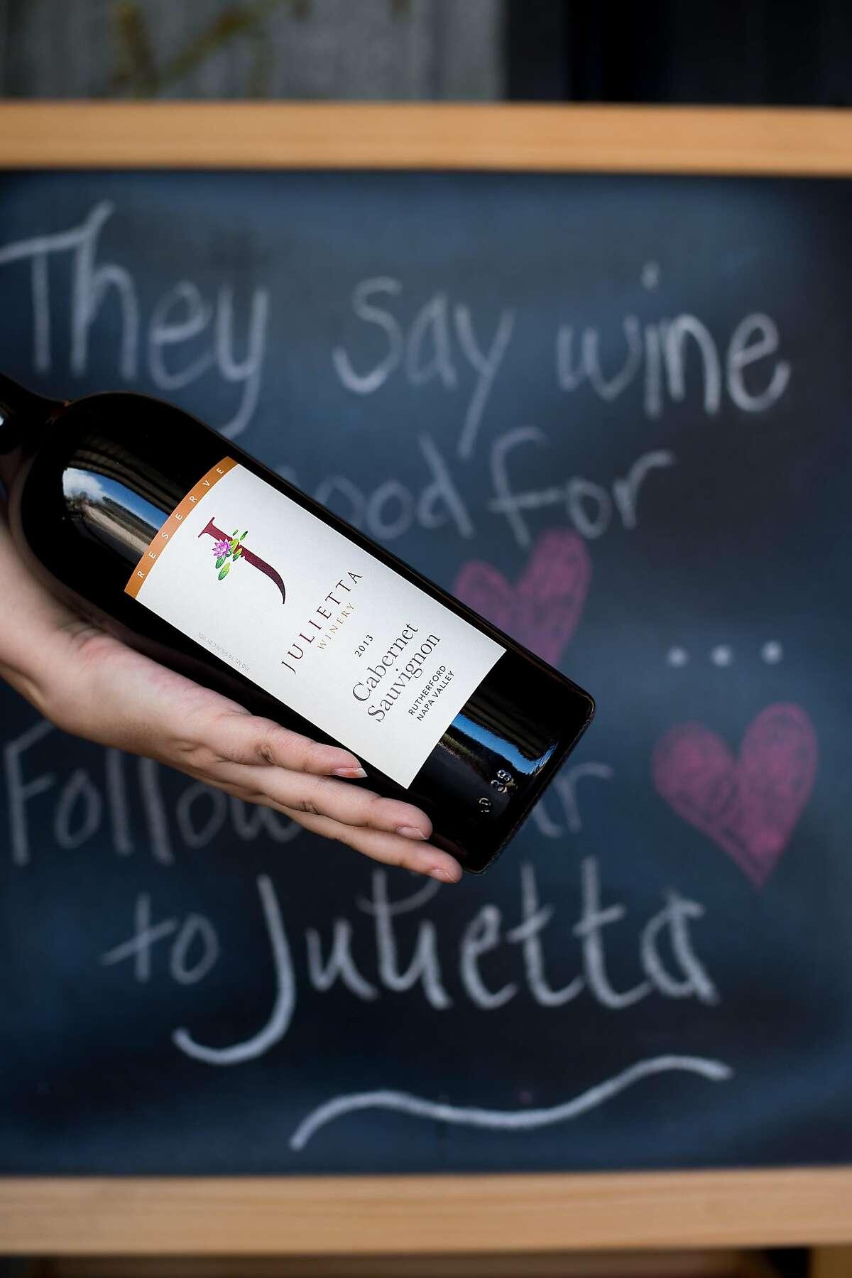 Kirsten Palmer displays a bottle of Cabernet Sauvignon at Julietta Winery in Clarksburg, Calif., on Saturday, March 11, 2017.
