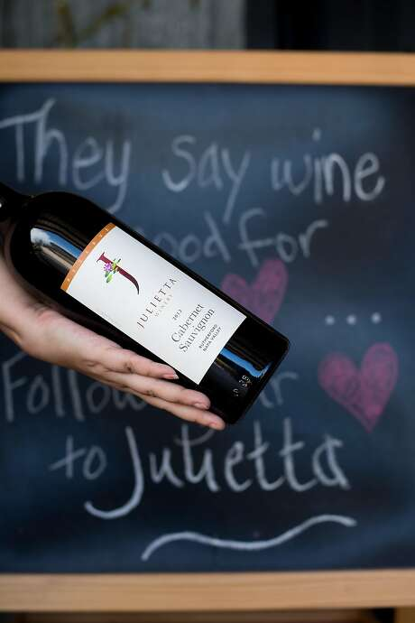 Kirsten Palmer holds a bottle of Cabernet Sauvignon at Julietta Winery in Clarksburg (Yolo County). Photo: Noah Berger, Special To The Chronicle