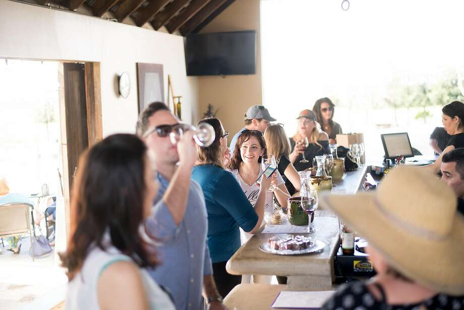 Jennifer Foster-Hayes (center) tastes wine at Miner's Leap Winery. Photo: Noah Berger, Special To The Chronicle