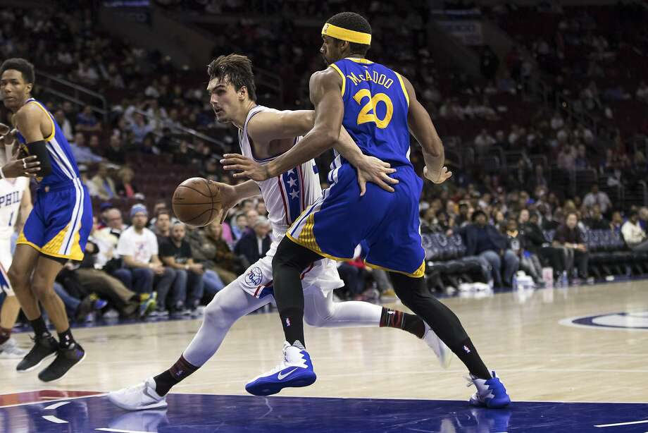 Philadelphia 76ers' Dario Saric, left, drives to the basket against Golden State Warriors' James Michael McAdoo, right during the second half of an NBA basketball game, Monday, Feb. 27, 2017, in Philadelphia. The Warriors won 119-108. (AP Photo/Chris Szagola) Photo: Chris Szagola, Associated Press