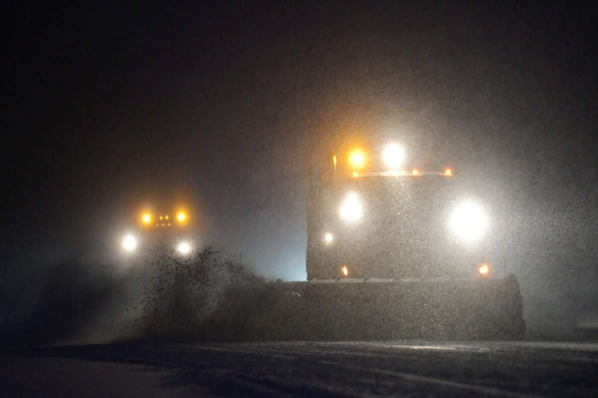 Snow plows were out early on Route 9 in Colonie on Tuesday clearing the first inches of what could be two feet of snow dropped by a storm that forecasters say could become a blizzard. (Skip Dickstein / Times Union)