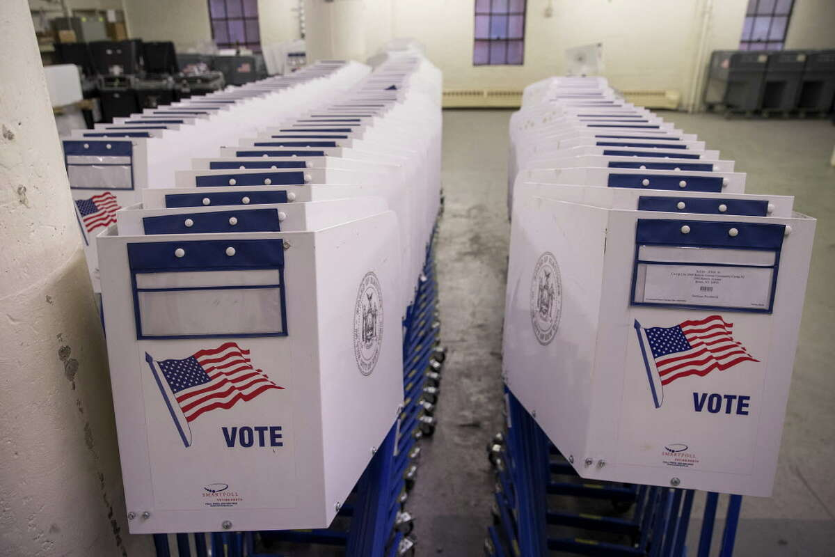 NEW YORK, NY - NOVEMBER 3: Voting booths sit at a New York City Board of Elections voting machine facility warehouse, November 3, 2016 in the Bronx borough in New York City. The voting booths, ballot scanners and other supplies will be picked up on Monday and delivered to area Bronx polling places ahead of Tuesday's election. (Photo by Drew Angerer/Getty Images) ORG XMIT: 680513303