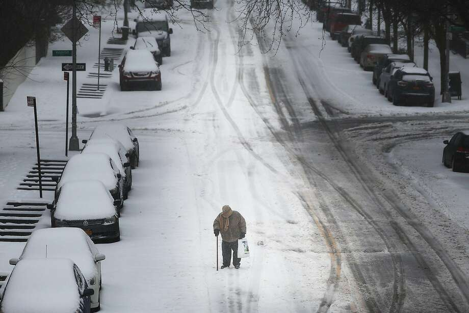 An elderly man with a cane struggles in the sleet and snow on March 14, 2017 in New York City. New York City and New Jersey are under a state of emergency as a blizzard is expected to bring over one foot of snow and high winds to the area. Schools, flights, businesses and public transportation are closed or restricted throughout the area.  (Photo by Spencer Platt/Getty Images) Photo: Spencer Platt, Getty Images