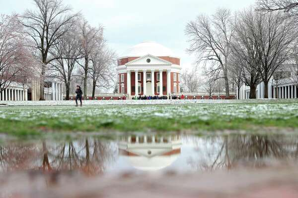 Tour groups visit the Rotunda at the University of Virginia in Charlottesville, Va., as a dusting of overnight snow begins to melt on the Lawn on Tuesday, March 14, 2017. (Ryan M. Kelly/The Daily Progress via AP)