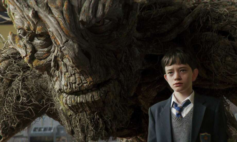 "The Monster joins Conor (Lewis MacDougall) for lunch in 'A Monster Calls."" Photo: Focus Features / 2016 Focus Features, LLC."