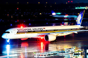 Singapore Airlines began flying the Airbus A350 on its Houston-Manchester route, with continuing service to Singapore, in January 2017. The aircraft pictured is at Bush Intercontinental Airport on March 4, 2017. Photo by Nathan Moeller with   Astro95 Media  .