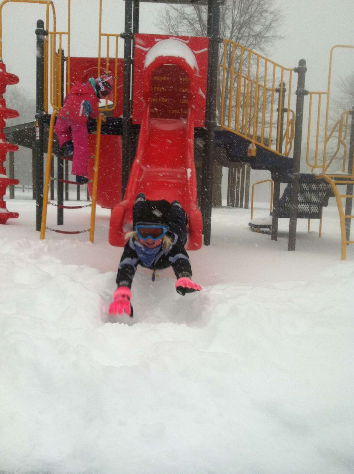 4-year-old Lily spends a snow day off from school on a makeshift luge run at Avon Crest Town Park in Niskayuna. (Photo provided by Betsy Sandberg)