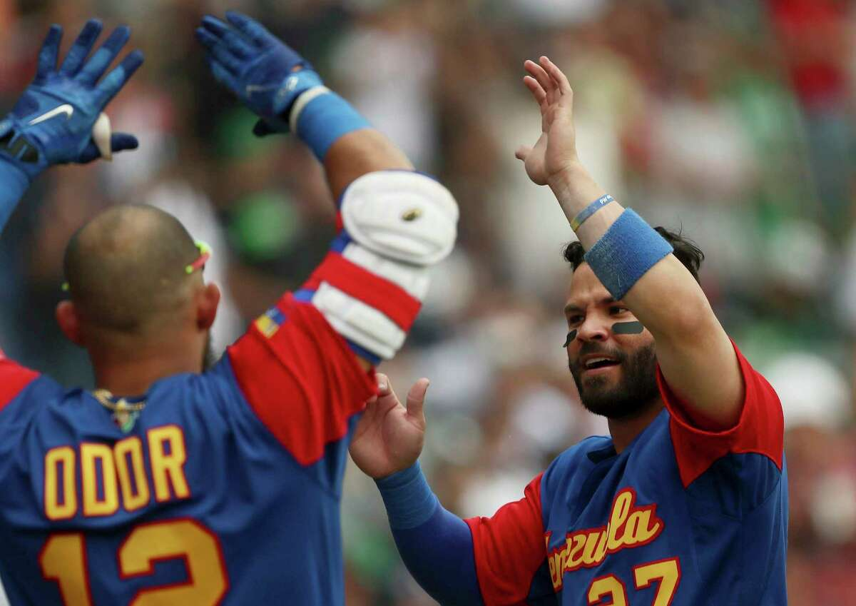 Venezuela's Jose Altuve of Venezuela, right, celebrates with his teammate Rougned Odor after scoring a run in the fifth inning of a World Baseball Classic game against Italy, in Guadalajara, Mexico, Saturday, March 11, 2017. (AP Photo/Luis Gutierrez)