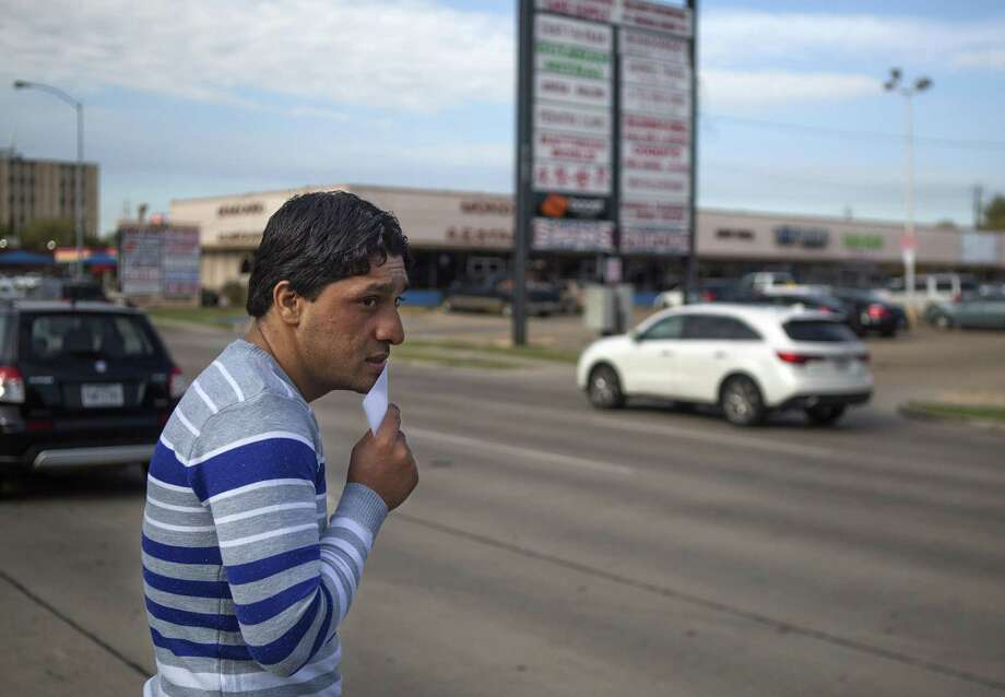 """Shaor Ahmad Safi crosses Hillcroft Avenue to cash his one-time $800 """"welcome money"""" check he just received from the Alliance for Multicultural Community Services, an agency of United Way, Thursday, Dec. 1, 2016, in Houston.  Shaor, who just immigrated to the United States two weeks ago, worked as a translator for the U.S. military in the Kandahar Province of Afghanistan accompanying American soldiers on patrols through the mountains. ( Mark Mulligan / Houston Chronicle ) Photo: Mark Mulligan, Staff / Houston Chronicle / © 2016 Houston Chronicle"""